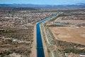 Free Irrigation Canal Through Suburbia Stock Photo - 26145160