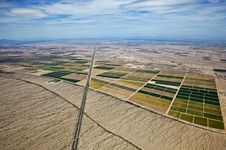 Free Farmland Meets The Desert Royalty Free Stock Photos - 26152548