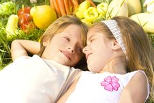 Children Enjoy In The Garden Stock Image