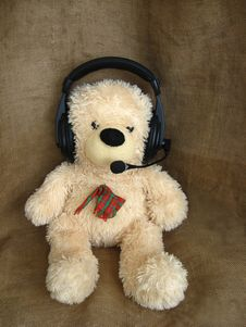 Toy Bear In Headphones Stock Images