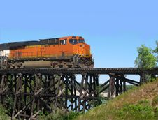 Free Train Locomotive Crossing A Trestle. Stock Photo - 26157110