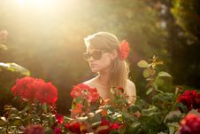 Free Young Woman In Flower Garden Smelling Red Roses 1 Stock Photo - 26161810
