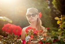 Free Young Woman In Flower Garden Smelling Red Roses 3 Royalty Free Stock Photography - 26161817