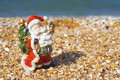 Free Toy Santa Claus At The Beach Stock Image - 26170301