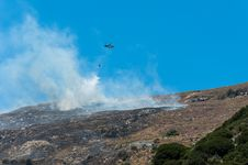 Helicopter Fighting A Bushfire