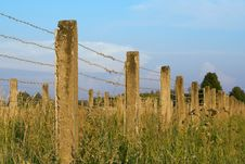 Free The Concrete Fence With Barbed Wire Royalty Free Stock Image - 26170336
