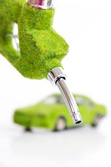 Free Hand Holding Eco Fuel Nozzle Stock Photography - 26179242
