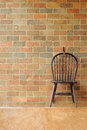 Free Red Brick Wall And Chair On The Wall Royalty Free Stock Photography - 26182707