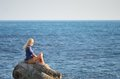 Free Girl In The Blue Shirt Looks At The Sea Royalty Free Stock Photo - 26183765
