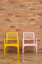 Free Bricyellow And Pink Chairs On Ancient Red Brick Royalty Free Stock Photography - 26185547