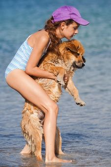 Young Girl Carries Her Dog Stock Photography