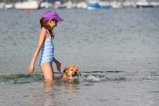 Cute Girl Plays With A Dog In The Water Royalty Free Stock Photo
