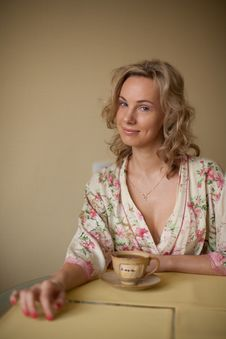 Free A Woman In A Dressing Gown Royalty Free Stock Photography - 26192527