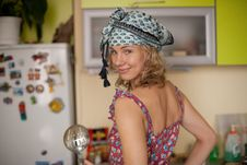 Funny Portrait Of The Housewife In The Kitchen Stock Photography