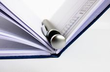 Free Notebook With Silver Pen Royalty Free Stock Images - 2621429
