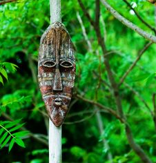 Tribal Mask On A Pole Royalty Free Stock Photo