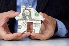 Hand Holding Banknote House Icon Stock Images