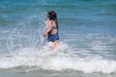 Free Young Girl Runs In The Wave Royalty Free Stock Photos - 26211628
