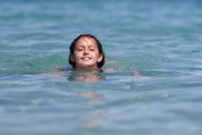 Free Smiling Girl Swims In The Sea Water Royalty Free Stock Image - 26213706