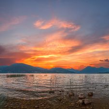 Free Sunrise On Lake With Majestic Clouds Stock Image - 26215941