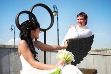 Free Bride And Groom On Bronze Bench Royalty Free Stock Photos - 26219798