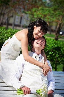Free Bride And Groom On Bench Stock Image - 26219841