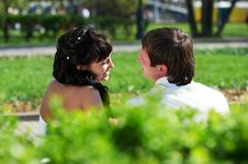Free Happy Bride And Groom On Bench Stock Photo - 26219870