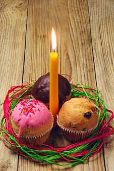 Free Three Cupcakes And A Burning Candle Stock Photography - 26227412