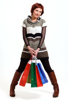 Free Attractive Woman Holding Shopping Bags Stock Photos - 26236923