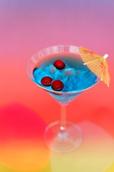 Frash Cocktail With Ice And Umbrella Stock Photography