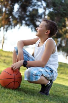 Boy With A Ball In The Fresh Air In The Park Stock Photos