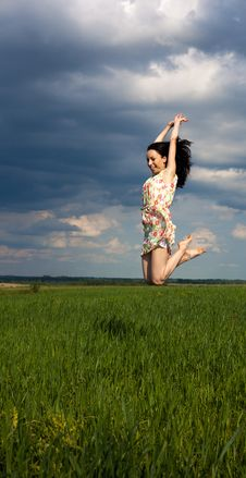 Young Girl Jumping On The Field