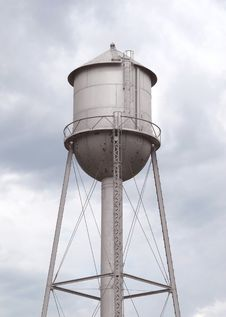 Old Fashioned Gray Metal Water Tower Stock Image