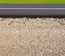 Rock And Soil Materials In The New Asphalt. Royalty Free Stock Photo