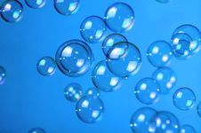 Soap Bubbles On Blue Stock Images