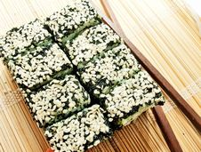 Free Sushi Rolls With Black Roe And Sesame Stock Images - 26254384
