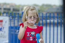 Free Girl Blowing Bubbles Stock Photo - 26269320