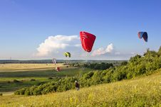 Multiple Paragliders Soar In The Air Stock Photos