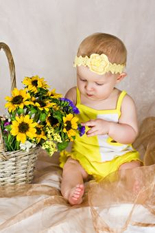 Free Baby Looking At Flowers Stock Images - 26283934