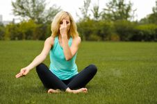 Young Girl Doing Yoga Outdoor Stock Photo