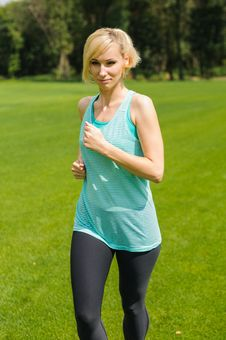 Free Portrait Of A Young Woman Jogging Royalty Free Stock Photos - 26290958