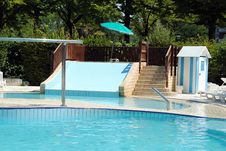 Free Limpid Swimming Pool And A Waterslide Stock Photography - 26291972