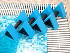 Four Blue Aqua Dumbbells Stock Photo