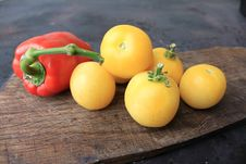 Free Beautiful Yellow Tomatoes And Bell Pepper Royalty Free Stock Photography - 26300387