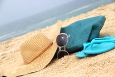 Free Blue Beach Bag On The Seacoast And Straw Hat Stock Photography - 26302422