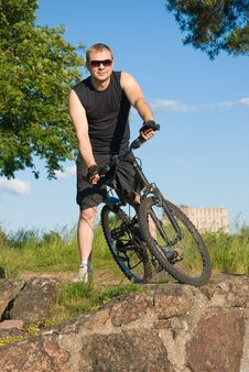 Free Young Man On A Mountain Bike Royalty Free Stock Photo - 26312095