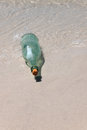 Free Message In A Bottle On Sand Royalty Free Stock Photos - 26335538