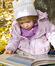 Free Girl Reads A Book Royalty Free Stock Photography - 26347157