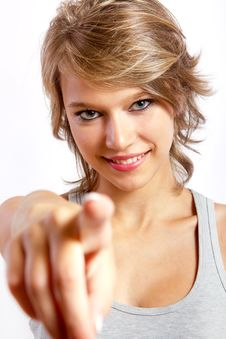 Beautiful Blonde Girl Pointing To The Camera Royalty Free Stock Photos