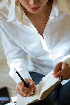 Free Young Woman Taking Notes Stock Photos - 26345973